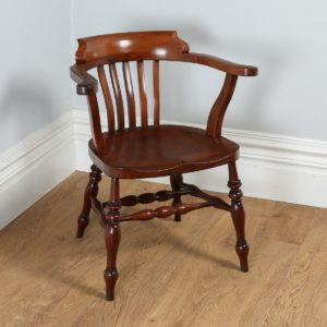 Antique English Victorian Mahogany Smokers' Bow Office Desk Armchair by J.W. Read & Co. (Circa 1880)
