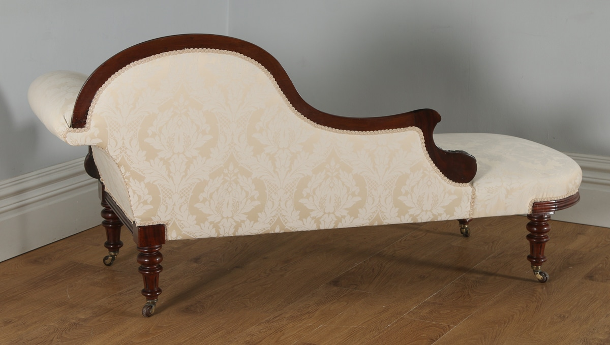 Antique english victorian mahogany upholstered chaise for Antique victorian chaise longue