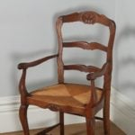 Antique Set of 12 French Louis XV Style Oak Ladder Back Rush Seat Dining Chairs (Circa 1910)