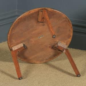 Vintage English Circular Oak Coffee Table by Herbert E. Gibbs (Circa 1940) - yolagray.com